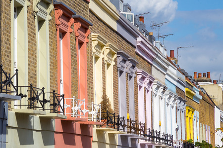 town houses: Traditional colorful houses in Camden Town district - London, United Kingdom