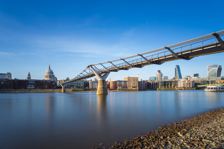 st paul s cathedral: St Pauls Cathedral and Millennium Bridge with Bank district in sunset, London, UK