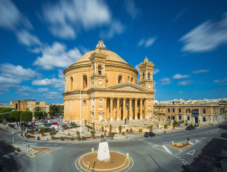 Long exposure shot about the famous Mosta Dome with moving clouds at daylight - Malta Redakční