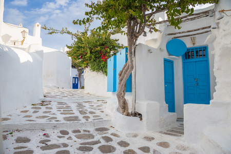 Mykonos streetview with blue door and trees, Greece Reklamní fotografie