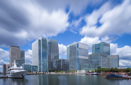 Skyscrapers of Canary Wharf with moving clouds in color, London, UK Reklamní fotografie