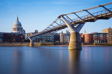 millennium bridge: St Pauls Cathedral and Millennium Bridge in sunset, London, UK