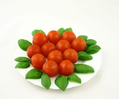 dewdrops: Some cherry tomatoes with dewdrops put together with fresh basil leaves Stock Photo