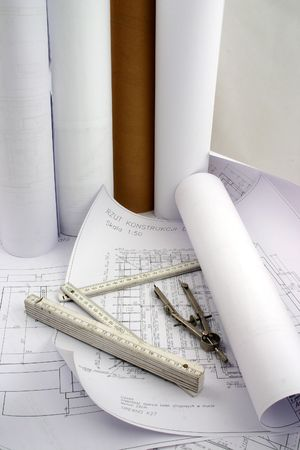 compasses: Building designs, some in a rolls of paper put together with construction measure and compasses   Stock Photo