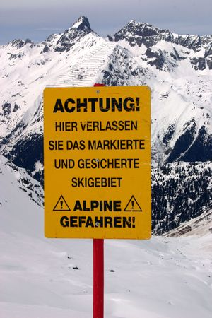 Close up at warning about leaving marked and protected piste photo