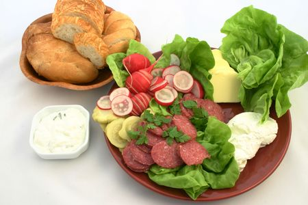 tzaziki: Sandwich ingredients put together on the plate next to bread and tzaziki