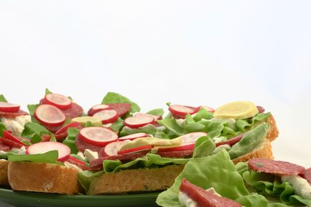 Close view at fresh sandwiches put on plate Stock Photo - 664593