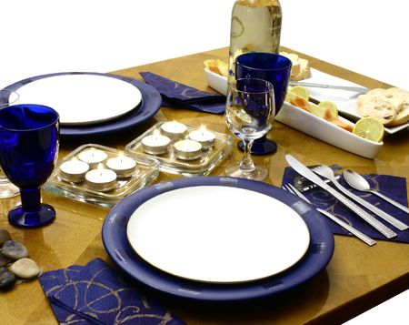 Wooden table with everything ready for ocassional dinner (perspective view) photo