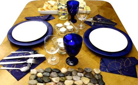 Wooden table with everything ready for occasional dinner (side view) photo