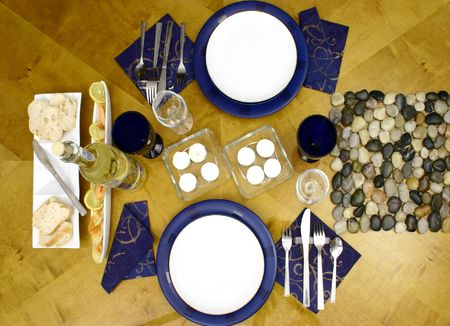 Wooden table with everithing ready for occasional dinner for two person (top view) photo