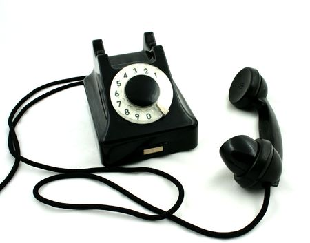 disconnect: Old black telephone with picked up receiver on the white background