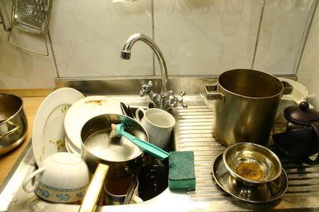 metal grater: Lots of kitchen dirty accessories in the sink Stock Photo