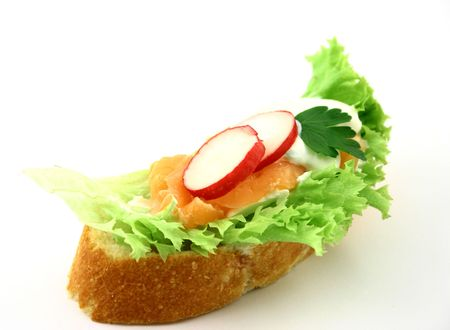Sandwich with salmon, radish, iceberg lettuce piece of parsley and tzatziki Stock Photo - 802745