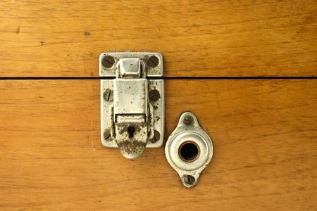 Close up at small retro lock with traces of corrosion photo