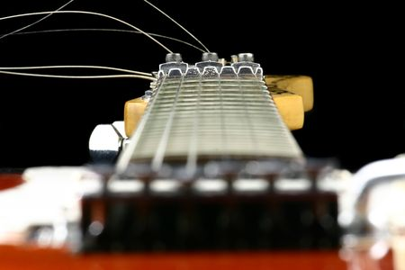 tremolo: Close up at guitar finger board with focus set on neck Stock Photo
