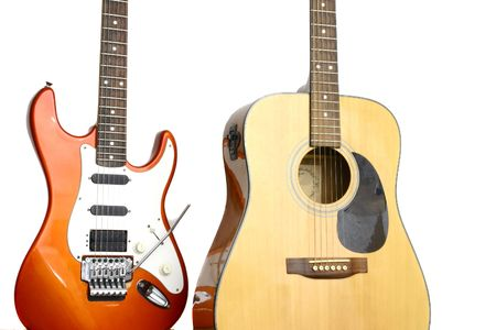tremolo: Red electric guitar and acoustic one standing together
