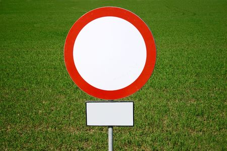 prohibitive: prohibitive sign with additional information on a green field