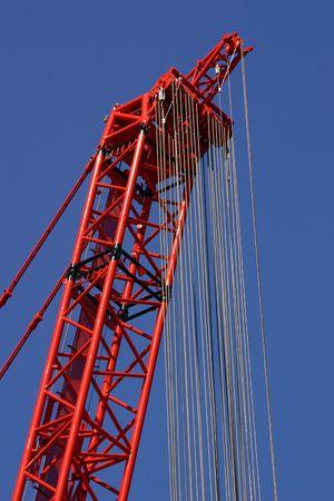 dozens: Powerful red crane with dozens of ropes