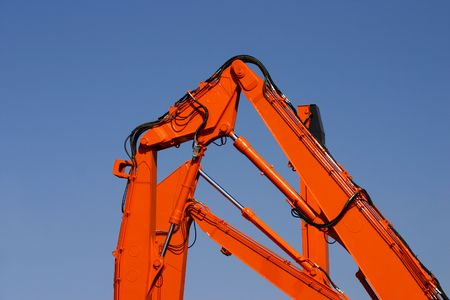 hydraulics: Heavy orange hydraulics of an excavators on a blue sky Stock Photo