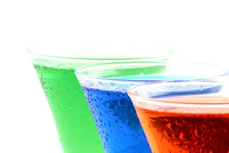Close up at cold colourful drinks on a white background photo