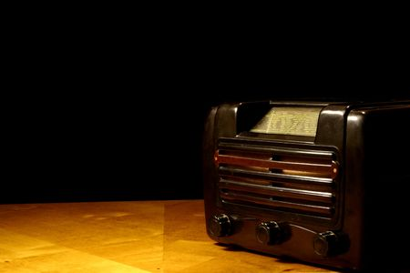 Angle view at vintage radio on a wooden table photo