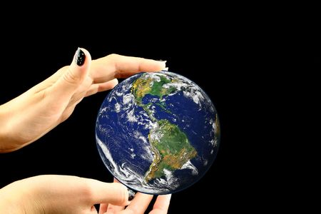 macrocosm: Earth being held by nice hands on a black background Stock Photo