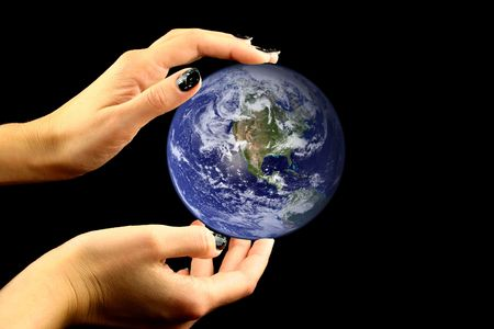 macrocosm: Mother earth held by nice hands on a black background Stock Photo