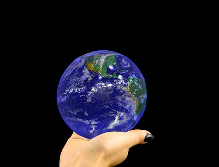 macrocosm: blue globe lying on a womans hand on a black background. Image of earth used under Terms and Conditions of Nasa http:visibleearth.nasa.gov