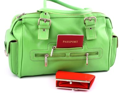 View at green handbag with passport in a pocket and red wallet photo