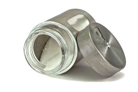 salt shaker: Salt shaker, jar with salt, lying on its side.Isolated.