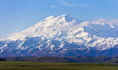elbrus: Wonderful Elbrus in light clouds. The Caucasus. Stock Photo