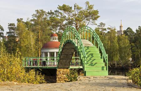 gazebo: The bridge and gazebo in autumn city park.