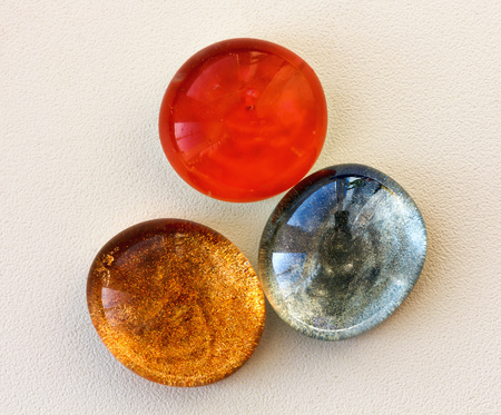 cabochon: Three colored cabochon for needlework.The oval shape. Stock Photo
