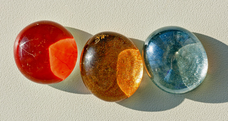 cabochon: Colored oval cabochons for crafts.On the window sill. Stock Photo