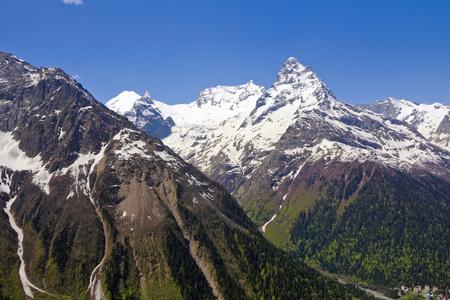 dombai: Majestic mountains around Dombai glade.The Caucasus.Russia. Stock Photo