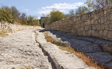leading: The road leading to the Eastern gate, in the medieval town-Chufut-Kale.Crimea. Stock Photo