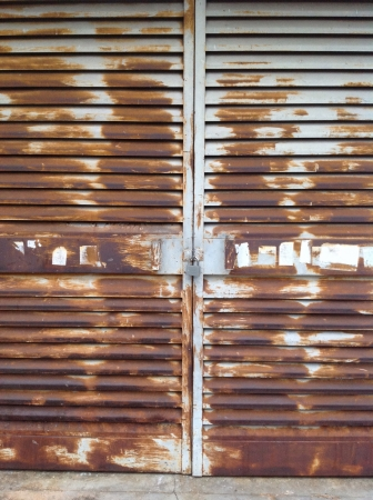 metal: Locked rusty metal doors