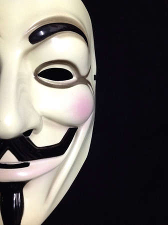 guy fawkes mask: Half of a Guy Fawkes mask on black