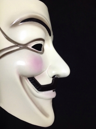 guy fawkes mask: Side profile of a Guy Fawkes mask on black