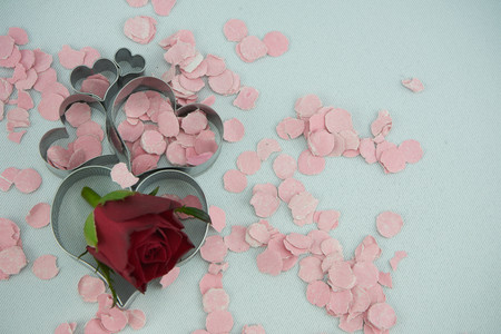 Heart with rose and confetti