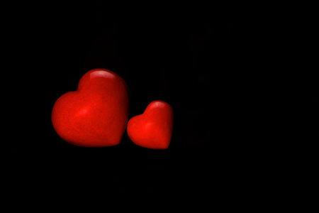 two hearts on black background
