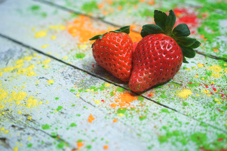 Strawberries on abstract background