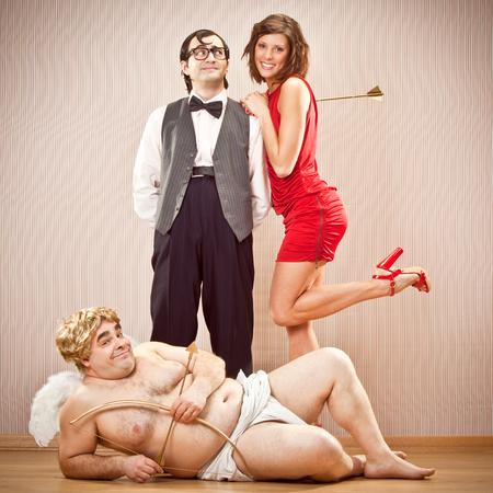 cupid man: shy nerd boyfriend man found love with cupid help for Valentine Day Stock Photo