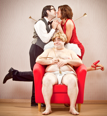 cupid man: nerd boyfriend man found love with cupid arrow help for Valentine Day Stock Photo