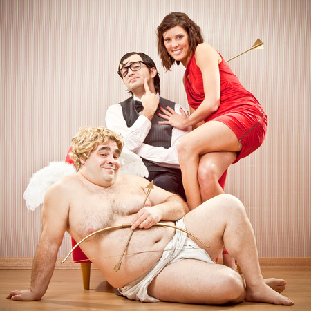 cupid man: nerd boyfriend man found love and ask for kiss with cupid help for Valentine Day Stock Photo