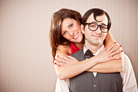 ugly man: nerd boyfriend man and beautiful woman couple in love close portrait for Valentine Day Stock Photo