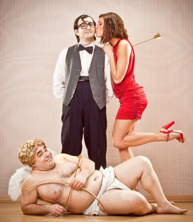 cupid man: confident nerd boyfriend man found love with cupid help for Valentine Day Stock Photo