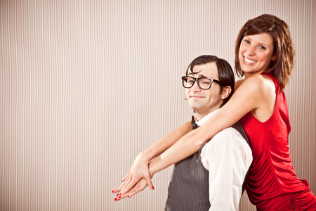 nerd boyfriend man and beautiful woman couple in love close portrait for Valentine Day Imagens