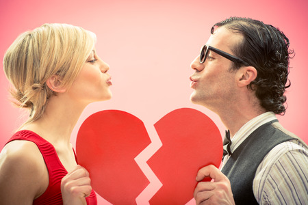 Nerd man boyfriend kiss his girlfriend love portrait with heart for valentine day