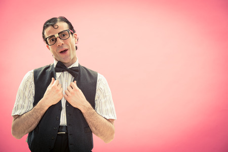 maldestro: Surprised man with nerd glasses portrait on pink think Archivio Fotografico